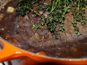 red wine pot roast with fresh thyme before going in the oven
