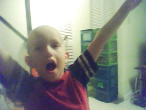 The Cancer-Patient-Impersonating, Singing-Bus-Rider Sensation, Logan. In all his glory.