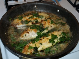Jalapeno Garlic Tilapia in the pan after adding spinach, jalapenos, etc.